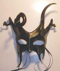 Jester or devil? Curled horns & menacing fangs give character to this sculpted leather mask.