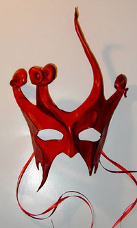 Sculpted leather fantasy mask with horns & fangs.
