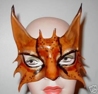 Sculpted leather cat mask with leapard markings.